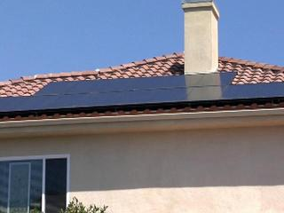 solar-panels-house-roof-092310-25138049.jpg