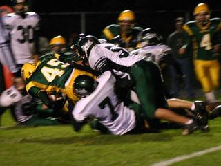 Image-High-School-football-tackle-14005793.jpg
