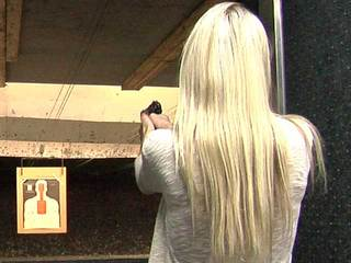 Woman shooting at gun range