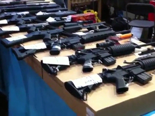 Guns lined up at a gun show