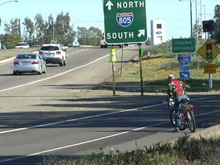 Bicyclist attempts to cross I-805 on ramp