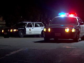 San Diego police patrol cars at night