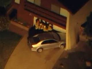 Car crashes into garage