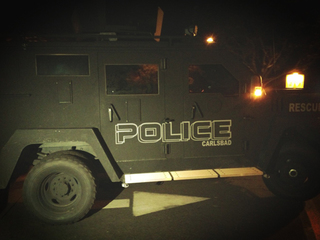 Carlsbad police armored vehicle with evacuees