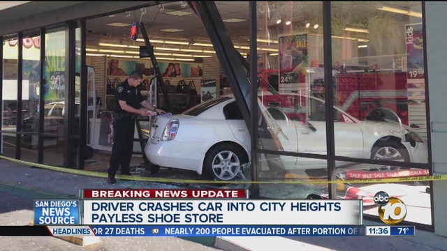 Fire crews say a car has crashed into a Payless Shoe Store at