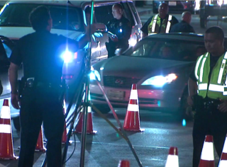 Alleged DUI driver hits gas at checkpoint