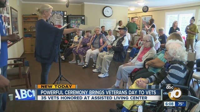 honored at an assisted living center during a veterans day ceremony
