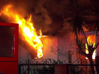 Trapped boy dies in raging Mount Hope house fire
