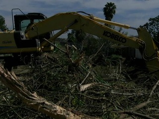 Storm channel cleanup continues despite heat