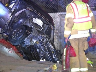4 injured when car crashes into concrete barrier