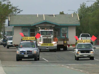 On the move: Truck takes house to new location