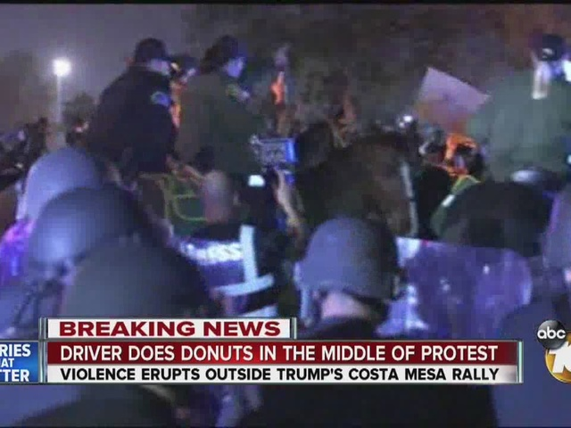 Driver does donuts in middle of protest outside Donald Trump rally