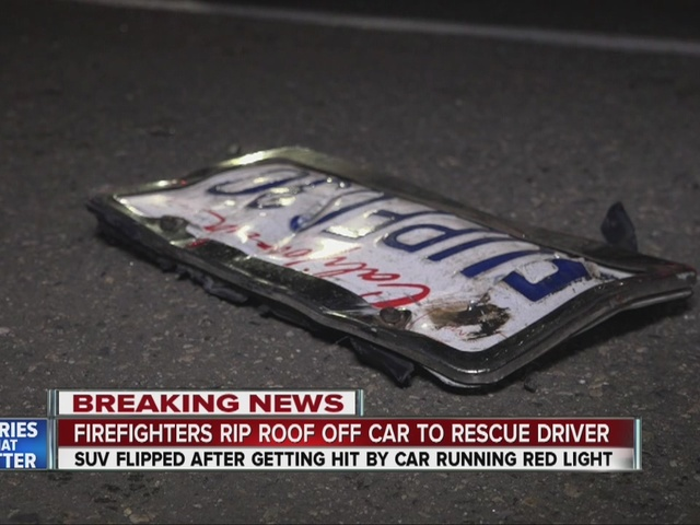 Firefighters cut roof to rescue trapped driver after hit-run