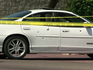 Infant in car as dad shot to death