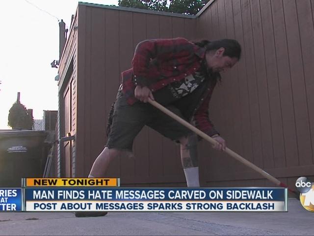 Man finds hate messages carved on sidewalk