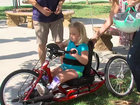 Community helps replace girl's stolen handcycle
