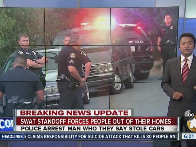 SWAT standoff forces people out of their homes
