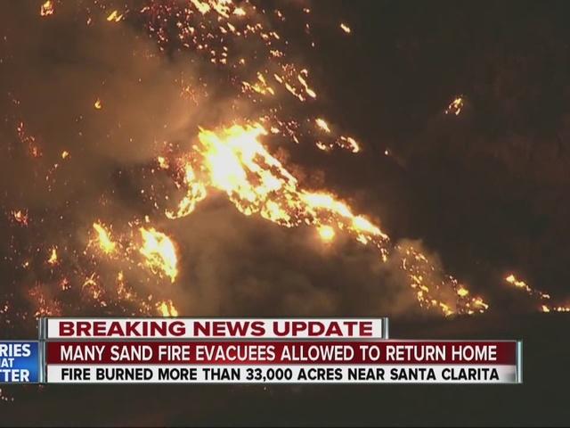 Evacuees return but huge Sand Fire still raging