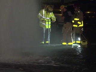 Geyser shoots up after car careens into hydrant