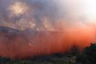 Wildfire near Calif. Air Force base rages on