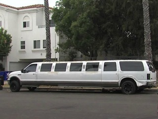 Neighbors claim people living in abandoned limo