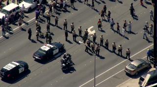Police protesters march through El Cajon