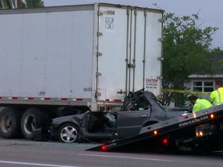 Man dies after crashing car into semi-truck