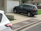 Family ticketed for parking in own driveway