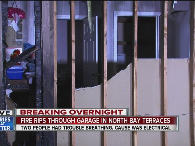 Residents race to get car out of burning Bay Terraces garage