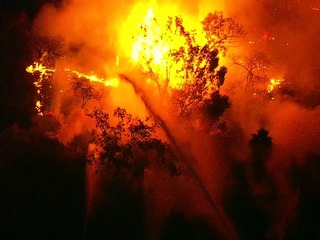 Brush fire lights up the night in Mission Valley