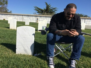 Veteran plays music at grave of fallen comrade