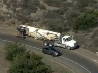 Truck overturns on NB I-15 ramp to WB SR-52