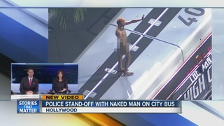 VIDEO: Naked man struts on top of Hollywood bus