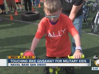 Bikes, signed footballs given to military kids