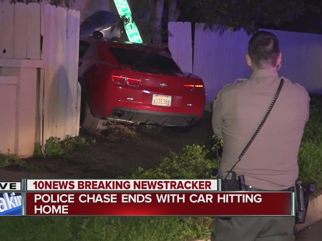 Police chase ends with car driving into a home