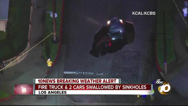 Fire truck and 2 cars swallowed by sinkholes
