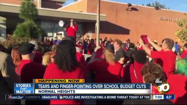 Tears and finger-pointing over school budget cuts