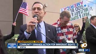 Dozens demand action outside Rep. Issa's home