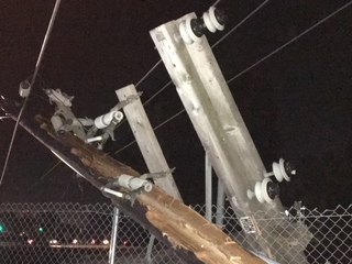 Car plows through power pole, causing outages