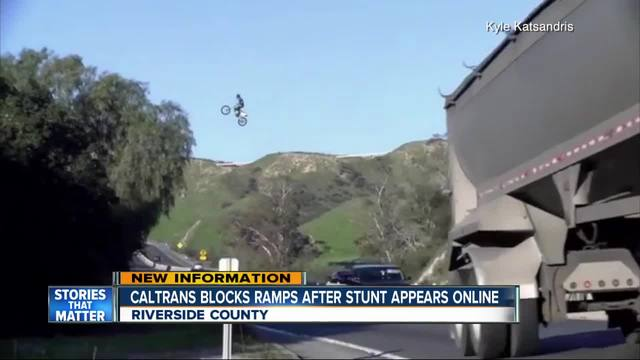 Biker jumps over busy highway