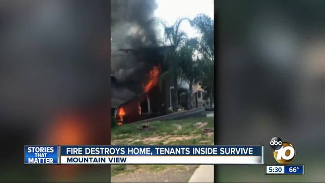 Fire destroy home- tenants inside survive