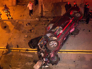 Driver survives after truck plunges off freeway