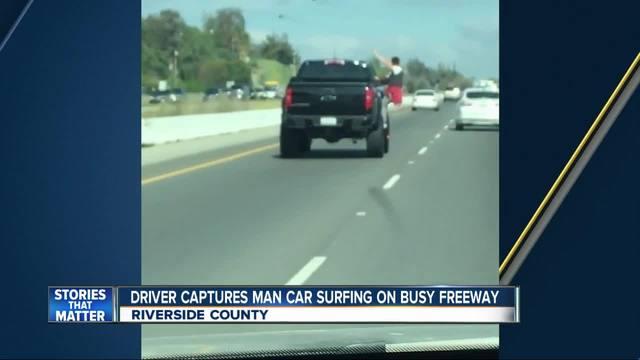 Video- Man car surfing on 15 freeway