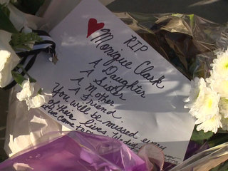 Vigil held for mother of 3 killed in shooting