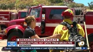 Crews tackle fire between Escondido homes, I-15
