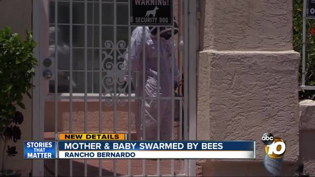 Mother - baby swarmed by bees