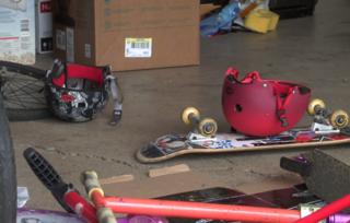 Thief raids garage, targets boys' belongings