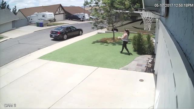 Home security camera captures woman taking package from Santee home - 10News