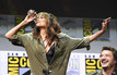 Halle Berry downs whiskey at Comic-Con panel