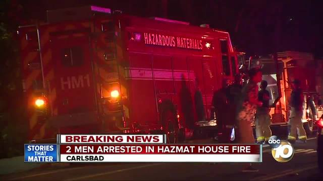Two men arrested in hazmat house fire